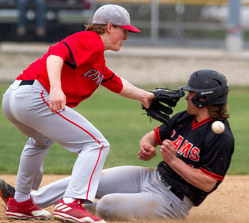 Effingham shortstop Mason Hull tries to catch a throwout attempt as Mt. Vernon's Gage Burroughs slides into the base safe.