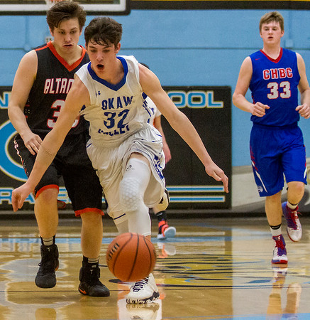 LOVC's Connor Cloyd, center, runs after a loose ball with NTC's Ryan Armstrong, left, on his trail and Aaron Nohren, right, not far behind during the first half of the 24th Annual Central Illinois All-Star game at Cumberland High School. The NTC won 97-87.