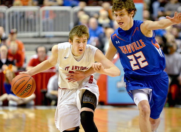 St. Anthony's Drew Gibson brings the ball upcourt while being pressured by Okawville's Shane Ganz during the Class 1A state championship game.