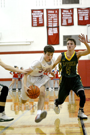 St. Anthony's Cade Walsh drives past Patoka's Skylar Webb during the Class 1A Nokomis Sectional final.