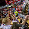 St. Anthony's Drew Gibson, center, and Alex Deters, left, grab hold of their Class 1A state championship trophy after defeating Okawville 49-46 in Peoria.
