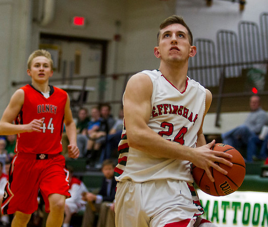 Effingham's Grant Wolfe eyes the basket on a breakaway while Olney's Sutton Dunn, left, watches helplessly from behind at the Class 3A Mattoon Regional.