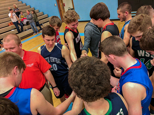 The NTC All-Star team huddles for one last break following their 97-87 win over the LOVC at Cumberland High School.