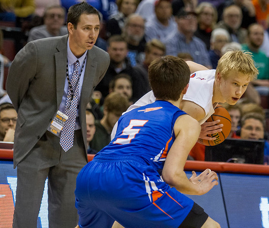 St. Anthony's Alex Deters, right, listens to head coach Cody Rincker, left, while being guarded by Okawville's Caleb Frederking.