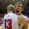 St. Anthony senior Drew Gibson lets out an excited shout as he and teammate Alex Deters embrace following the Bulldogs' 52-50 Class 1A SIU Super-Sectional win over Woodlawn in Carbondale.