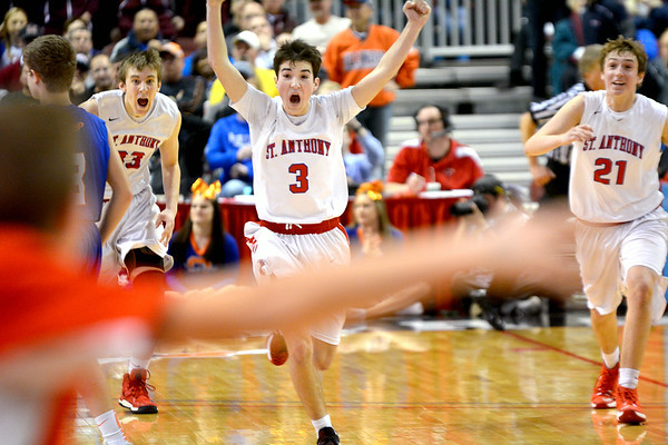 St. Anthony's Drew Gibson (33, left), Cade Walsh (3, center) and Adam Levitt (21, right) rush toward the St. Anthony bench seconds after winning the Class 1A state championship against Okawville in Peoria.