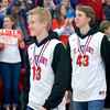 St. Anthony's Alex Deters (13) and Alex Beesley (43) walk in to the Enlow Center for the Bulldogs' reception after winning the Class 1A state championship.