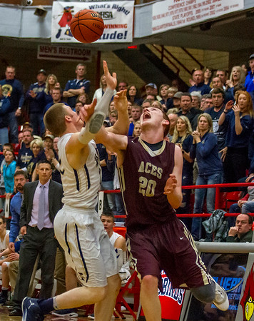 Teutopolis' Blake Mette and Mt. Carmel's Justin Carpenter vie for a loose ball as the Shoes' head coach Jason Hanson, left, and fans watch during the fourth quarter of the Class 2A West Frankfort Sectional semifinal.