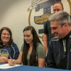 Teutopolis' Shelby Thompson, center, committed to play basketball at Lincoln Land College beginning in the fall. She is surrounded by her mother Laurie, left, and father Jeff, right. Back row is Teutopolis girls assistant basketball coach Josh Cottrill. Thompson will reunite with former Teutopolis basketball player Molly Smith, who finished her freshman year as a Logger this past season.