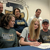 Teutopolis' Jamie Sandschafer, center, committed to play basketball at Lake Land College beginning in the fall. She is surrounded by (front row) her mother Lori, left, and father Corey, right. Back row, Teutopolis girls assistant basketball coach Josh Cottrill, left, head coach Laurie Thompson, center, and Lake Land College head coach Dave Johnson.