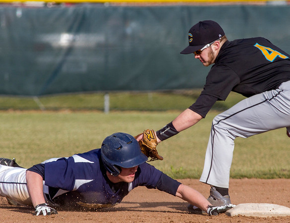Teutopolis' Lane Belleville, left, slides into second base as Cumberland's Hayden Kanizer attempts the tag out.
