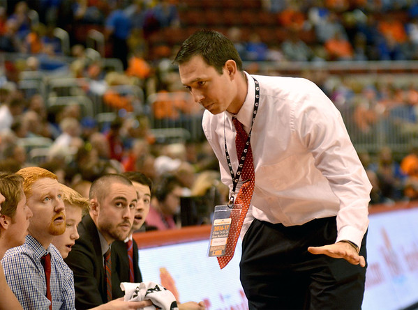 St. Anthony coach Cody Rincker addresses his team on the bench during the Class 1A state semifinal against Chicago Hope Academy in Peoria.
