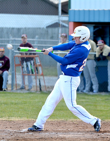 Newton's Mitch Bierman lines a single to right field during the third inning of Newton's 9-2 win over Mt. Carmel.