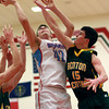 3-1-13<br /> Maconaquah vs. Benton Central basketball<br /> Maconaquah's Micah Pier reaches up for a rebound, while Benton Central'sNick Fischbach reaches toward it during Friday's game.<br /> KT photo | Kelly Lafferty
