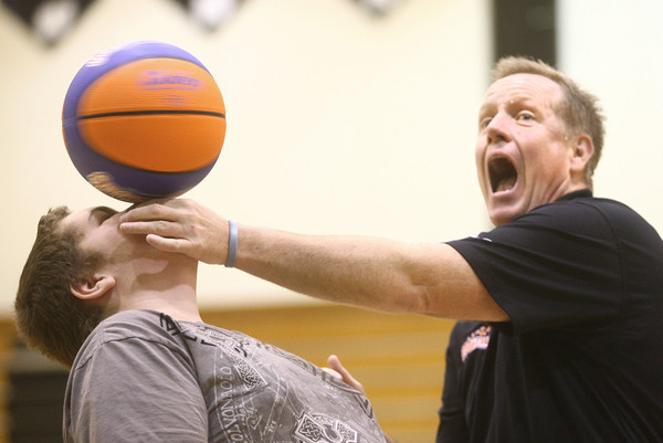 """3-19-14<br /> Jim """"Basketball"""" Jones anti-bullying<br /> Jim """"Basketball"""" Jones reacts as he balances a spinning basketball on Sam Griffin's nose at Western High School.<br /> KT photo   Kelly Lafferty"""