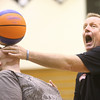 "3-19-14<br /> Jim ""Basketball"" Jones anti-bullying<br /> Jim ""Basketball"" Jones reacts as he balances a spinning basketball on Sam Griffin's nose at Western High School.<br /> KT photo 