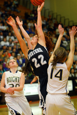 3-1-14  ---  Semi State girls basketball between Western HS and Norwell HS with western winning 41-31. Carley O'Neal going up for a shot between two Norwell players. -- <br /> KT photo | Tim Bath