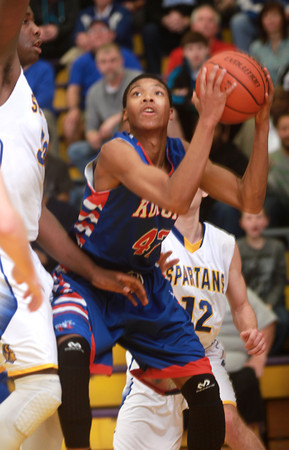 3-15-14<br /> Kokomo Regional Game against Homestead<br /> Kokomo's Demarius Warren looks for an opening to the basket.<br /> KT photo | Kelly Lafferty