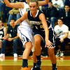 3-1-14  ---  Semi State girls basketball between Western HS and Norwell HS with western winning 41-31. Western's Jessica Givens drives around Norwell's Kelsey Beer drawing the foul. -- <br /> KT photo   Tim Bath