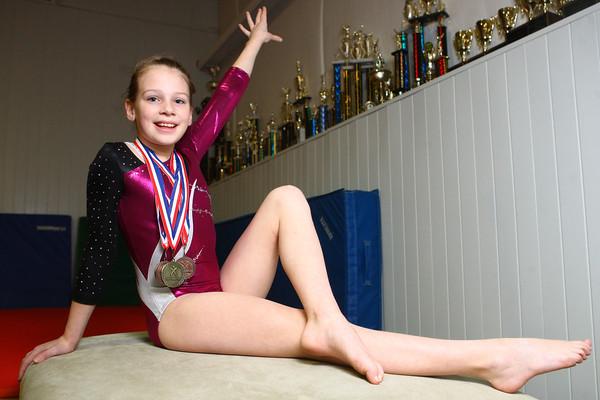 3-19-14<br /> Olivia Shoemaker of Kokomo Flipsters medaled at a recent gymnastics meet.<br /> KT photo | Kelly Lafferty