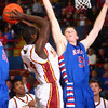 3-8-14<br /> Kokomo vs McCutcheon sectional championship<br /> McCutcheon's Darnell Buter makes a shot over Kokomo's Erik Bowen.<br /> KT photo | Kelly Lafferty