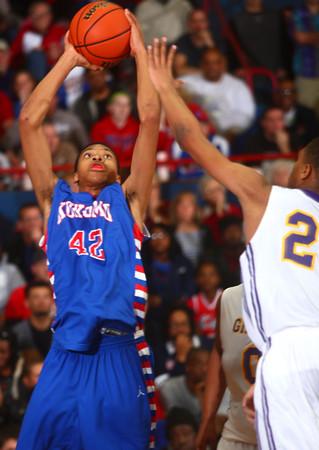 3-7-14<br /> Kokomo vs. Marion basketball<br /> Kokomo's Demarius Warren jumps up for a shot.<br /> KT photo | Kelly Lafferty