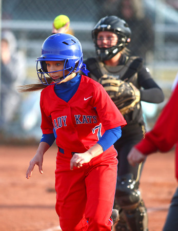 4-1-14<br /> Kokomo vs Lebanon softball<br /> Kokomo's Alexis Clark gets caught between third base and home and gets out.<br /> KT photo   Kelly Lafferty