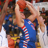 3-15-14<br /> Kokomo Regional Game against Homestead<br /> Kokomo's Brandon Wilson goes up for a shot and gets fouled by Homestead's Ryan Cotter.<br /> KT photo | Kelly Lafferty
