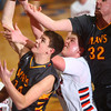 3-7-14<br /> Harrison vs. McCutcheon<br /> McCutcheon's Spencer Caldwell and Trevor Lockwood go up for a rebound against Harrison's Taylon Sondgerath.<br /> KT photo | Kelly Lafferty
