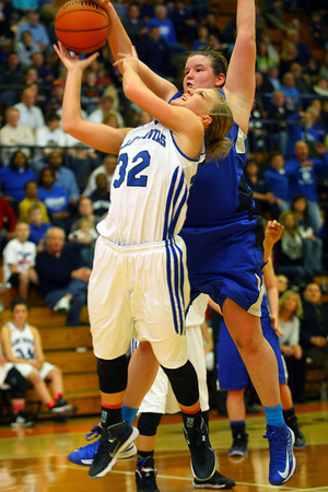 3-1-14  ---  Semi State girls basketball between Tipton and Canterbury. Tipton's Kacie Juday putting a shot up with Canterbury's Katherine Smith blocking the shot in the second half. -- <br /> KT photo   Tim Bath