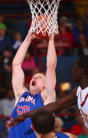3-8-14<br /> Kokomo vs McCutcheon sectional championship<br /> Kokomo's Erik Bowen puts up a shot.<br /> KT photo | Kelly Lafferty