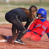 4-1-14<br /> Kokomo vs Lebanon softball<br /> Kokomo's Alexis Clark slides safely to second base as Lebanon's Brooke Montgomery tries to get her out.<br /> KT photo | Kelly Lafferty