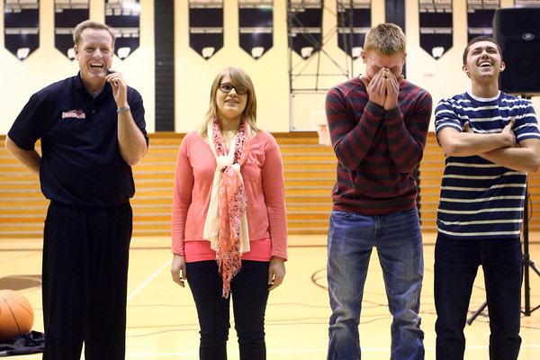 "3-19-14<br /> Jim ""Basketball"" Jones anti-bullying<br /> Olivia Peterson, Drew Bellus, and Tanner Degenkolb laugh with Jim ""Basketball"" Jones during the final round of Simon Says at Western High School during Jones' anti-bullying presentation.<br /> KT photo 