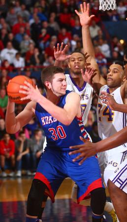 3-7-14<br /> Kokomo vs. Marion basketball<br /> Kokomo's Bradley Dockemeyer looks for a pass around Marion's defense.<br /> KT photo | Kelly Lafferty