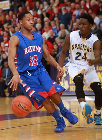 3-15-14<br /> Kokomo Regional Game against Homestead<br /> Kokomo's Jeron Gray tries to get past Homestead's Tahj Curry.<br /> KT photo | Kelly Lafferty