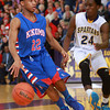 3-15-14<br /> Kokomo Regional Game against Homestead<br /> Kokomo's Jeron Gray tries to get past Homestead's Tahj Curry.<br /> KT photo | Kelly Lafferty