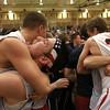 3-15-14<br /> Cass vs. Tipton Regional Championship<br /> Lewis Cass fan Kolbie Cox hugs #32 Drew McRae after Lewis Cass wins the regional championship.<br /> KT photo | Kelly Lafferty