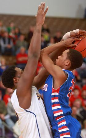 3-15-14<br /> Kokomo Regional Game against Homestead<br /> Kokomo's Mykal Cox goes up for a shot as Homestead's Caleb Swanigan tries to block him.<br /> KT photo | Kelly Lafferty
