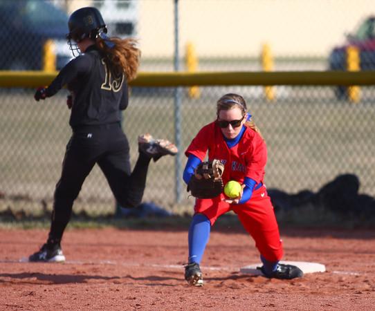 4-1-14<br /> Kokomo vs Lebanon softball<br /> Kokomo first baseman Miranda Ogle catches the ball, getting Lebanon's Jessica Weaver out.<br /> KT photo | Kelly Lafferty