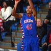 3-8-14<br /> Kokomo vs McCutcheon sectional championship<br /> Kokomo's Demarius Warren makes a three pointer during Kokomo's game against McCutcheon.<br /> KT photo | Kelly Lafferty