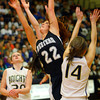 3-1-14  ---  Semi State girls basketball between Western HS and Norwell HS with western winning 41-31. Carley O'Neal going up for a shot between two Norwell players. -- <br /> KT photo   Tim Bath