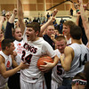 3-15-14<br /> Cass vs. Tipton Regional Championship<br /> Jake Martin celebrates with fans and teammates after Lewis Cass wins the regional championship game.<br /> KT photo | Kelly Lafferty