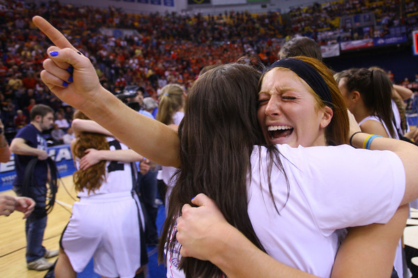 3-8-14  ---  State Girls Championship. Western girls cheer after winning the state Championship in Terre Haute. Caitlyn O'Neal hugging one of the team managers after winning the championship.-- <br /> KT photo   Tim Bath