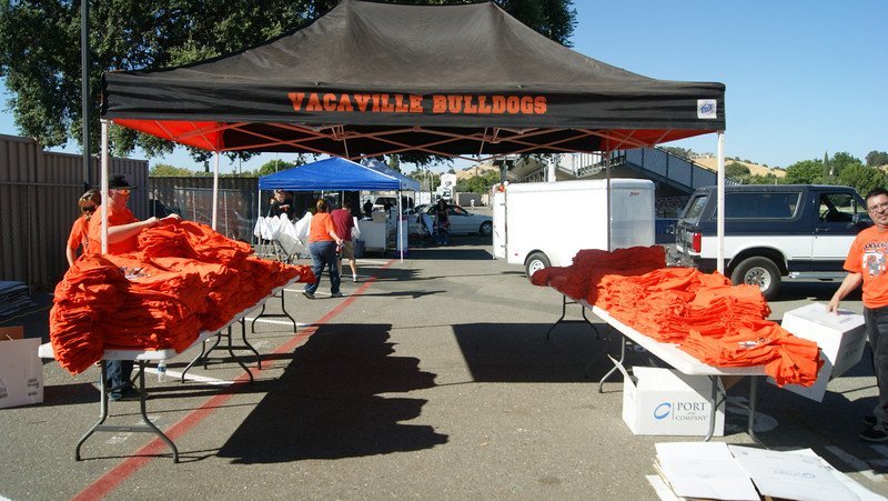Marin Catholic at Vacaville - September 7, 2012<br /> <br /> First home game of 2012 season! Orange-Out shirts are ready for Bulldog Nation. A Tradition started in 2008, Skyline Designs and Greggs Drilling design and print 3500 shirts to hand out to all fans at the season opener.