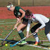 Nashoba's Jane Bonazzoli battles against Marlboro's Jillian Petrie in the Div I Field Hockey Championship Game at Grafton HS. Marlboro scored with 4 seconds left to dethrone Nashoba. SENTINEL & ENTERPRISE / Jim Marabello