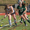 Nashoba's Hannah Gaffney digs in against Marlboro's Ciara Shanahan in the Div I Field Hockey Championship Game at Grafton HS. Marlboro scored with 4 seconds left to dethrone Nashoba. SENTINEL & ENTERPRISE / Jim Marabello