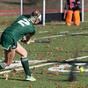 The fake dirt flies as Nashoba's Jane Bonazzoli lets go with a shot agianst Marlboro in the Div I Field Hockey Championship Game at Grafton HS. Marlboro scored with 4 seconds left to dethrone Nashoba. SENTINEL & ENTERPRISE / Jim Marabello