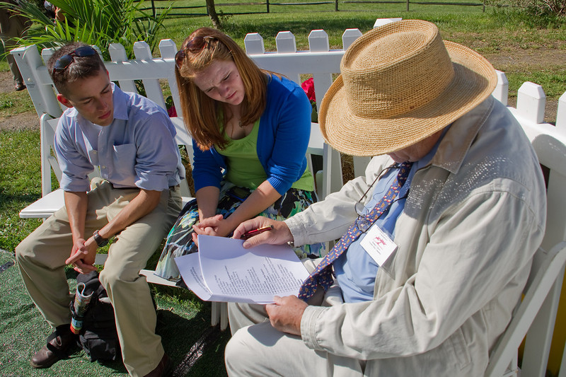 Rodney Calver notating the guest list for horse people to contact