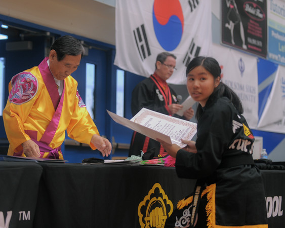 Elizabeth gets promoted to black belt at the 2016 WKSA Pacific Tournament, Folsom, CA.  April 16, 2016.