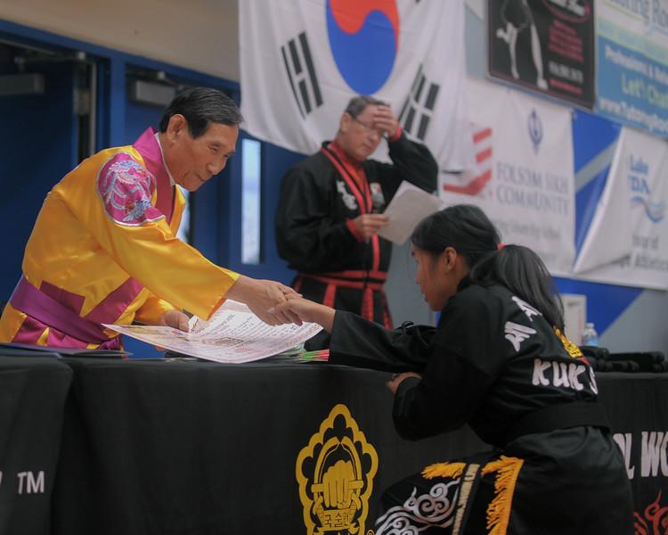 Elizabeth gets promoted to black belt at the 2016 WKSA Pacific Tournament, Folsom, CA.  April 16, 2016.